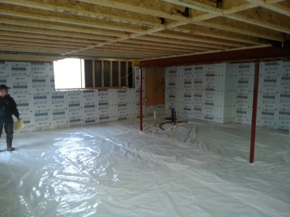 under construction home basement with white plastic on floor